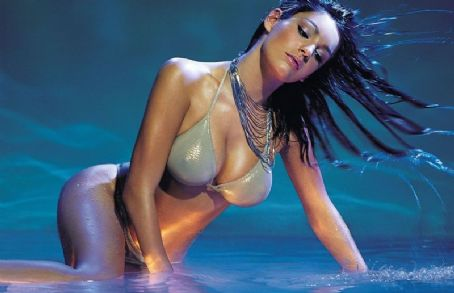 Kelly Brook laying in water
