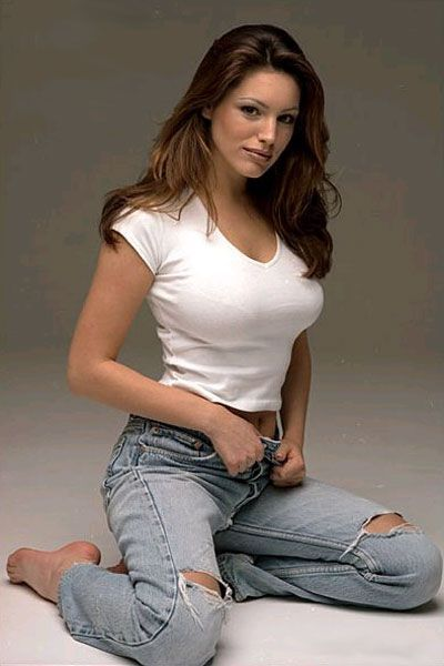 Kelly Brook Looking Sexy Jeans and White Top