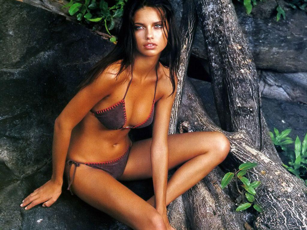Adriana Lima suede bikini jungle shoot